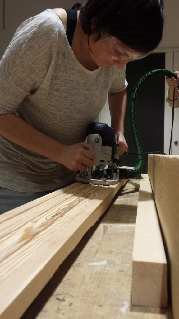 Erica doing heavy work at the carpentry.