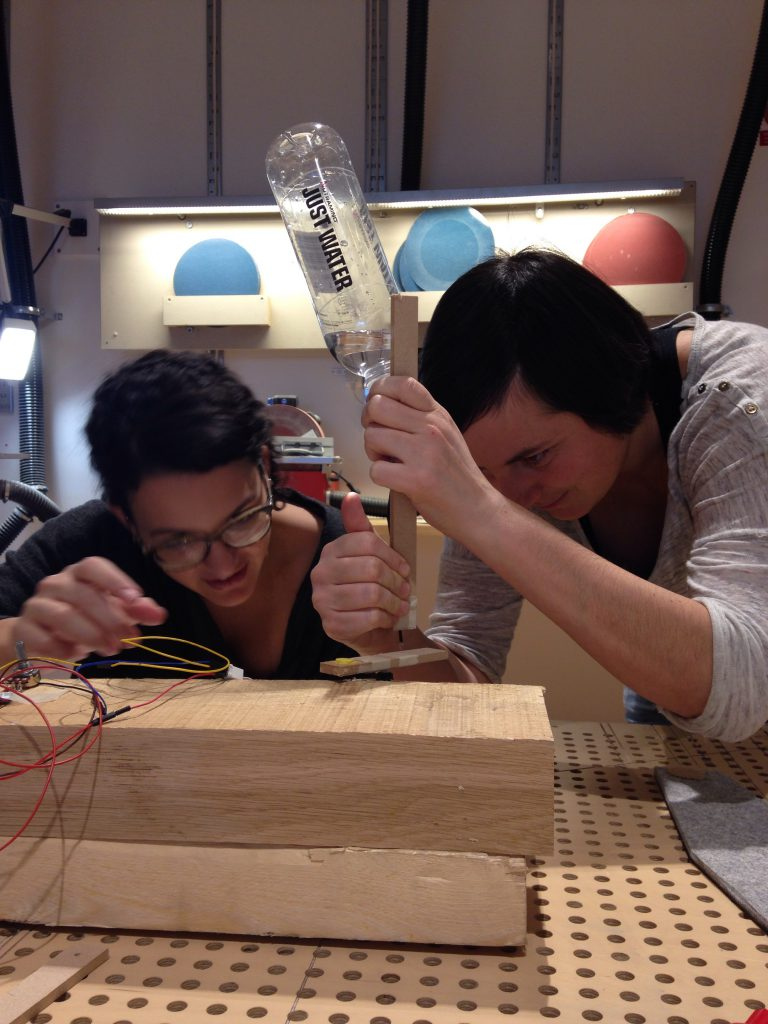 Me and Erica trying to make liquid and eletronics work together.